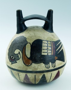 UNKNOWN ARTIST (Peruvian) Bridge-Spout Vessel, 100–300 buff clay with polychrome slip Museum Purchase, Florence C. Quinby Fund, in memory of Henry Cole Quinby, Honorary Degree, 1916 1969.86