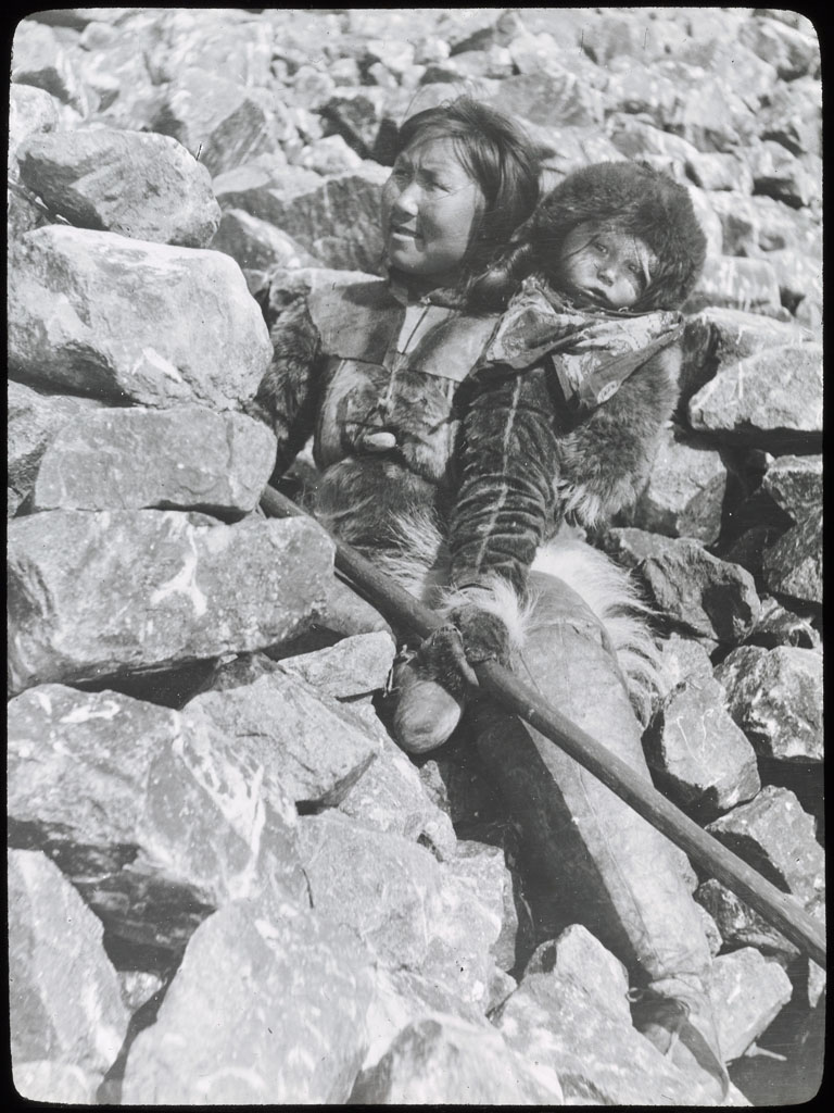 Donald Baxter MacMillan; Ah-nee-nah and Baby on Rocks; 1913-1917; image; silver gelatin on glass; 10.16 cm x 8.26 cm x 0.64 cm (4 in. x 3 1/4 in. x 1/4 in.); TGM; North America