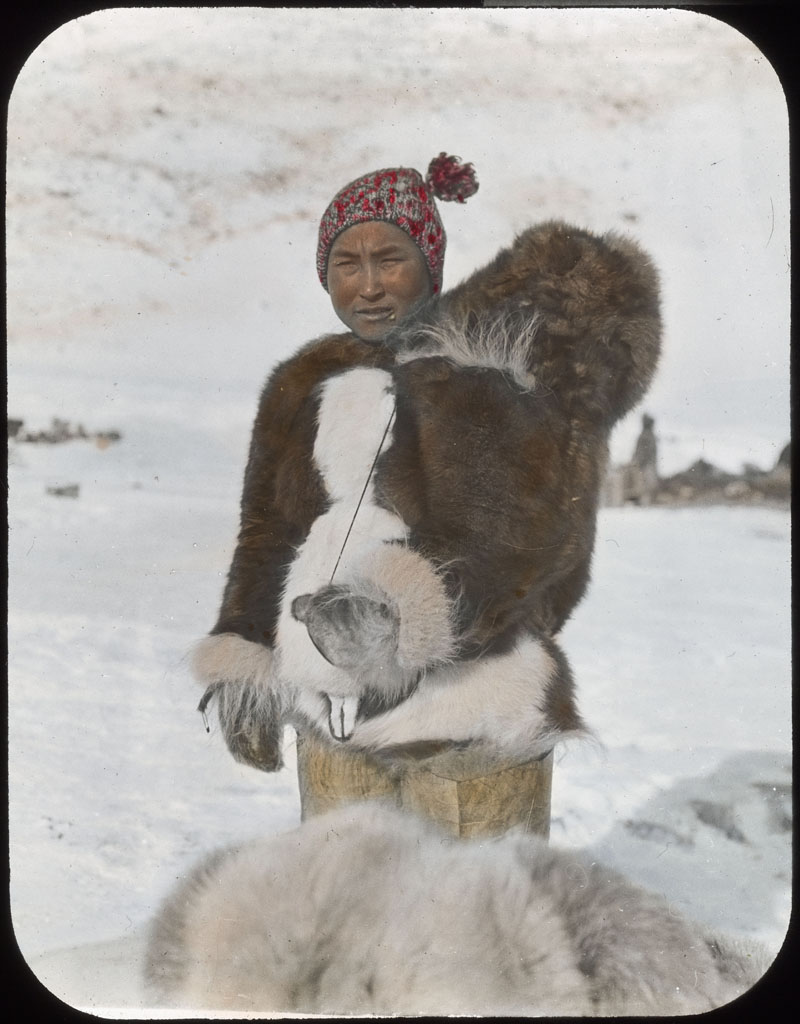 Donald Baxter MacMillan; Woman of Northwest Greenland. Baby in hood; 1913-1917; image; silver gelatin on glass; 10.16 cm x 8.26 cm x 0.64 cm (4 in. x 3 1/4 in. x 1/4 in.); TGM; North America