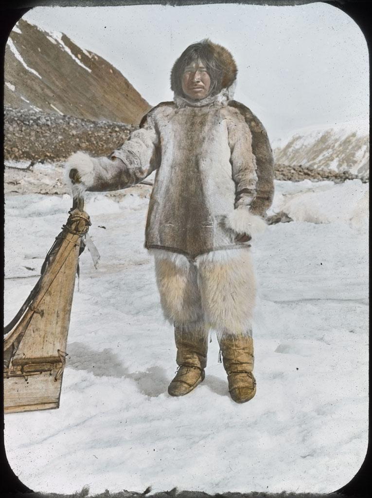 Etuk-e-suk standing by sledge