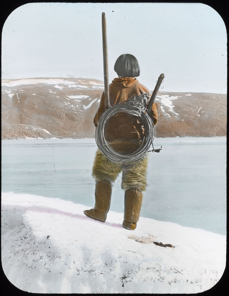 Donald Baxter MacMillan; Ka-ko-tchee-ah with hunting equipment; 1913-1917; image; silver gelatin on glass; 10.16 cm x 8.26 cm x 0.64 cm (4 in. x 3 1/4 in. x 1/4 in.); TGM; North America