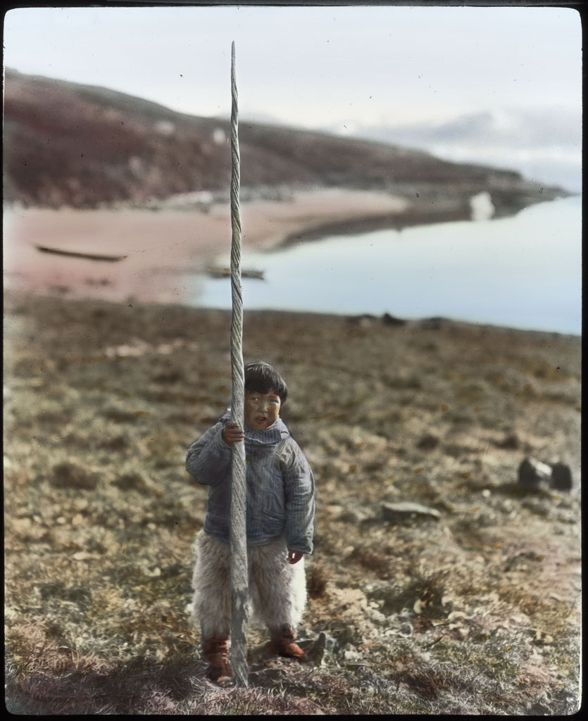 Narwhal tooth held upright by young boy