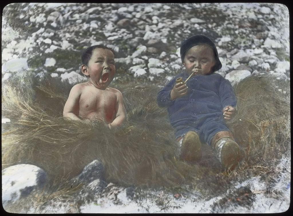 Donald Baxter MacMillan; Boys on muskox skin; 1913-1917; image; silver gelatin on glass; 10.16 cm x 8.26 cm x 0.64 cm (4 in. x 3 1/4 in. x 1/4 in.); TGM; North America