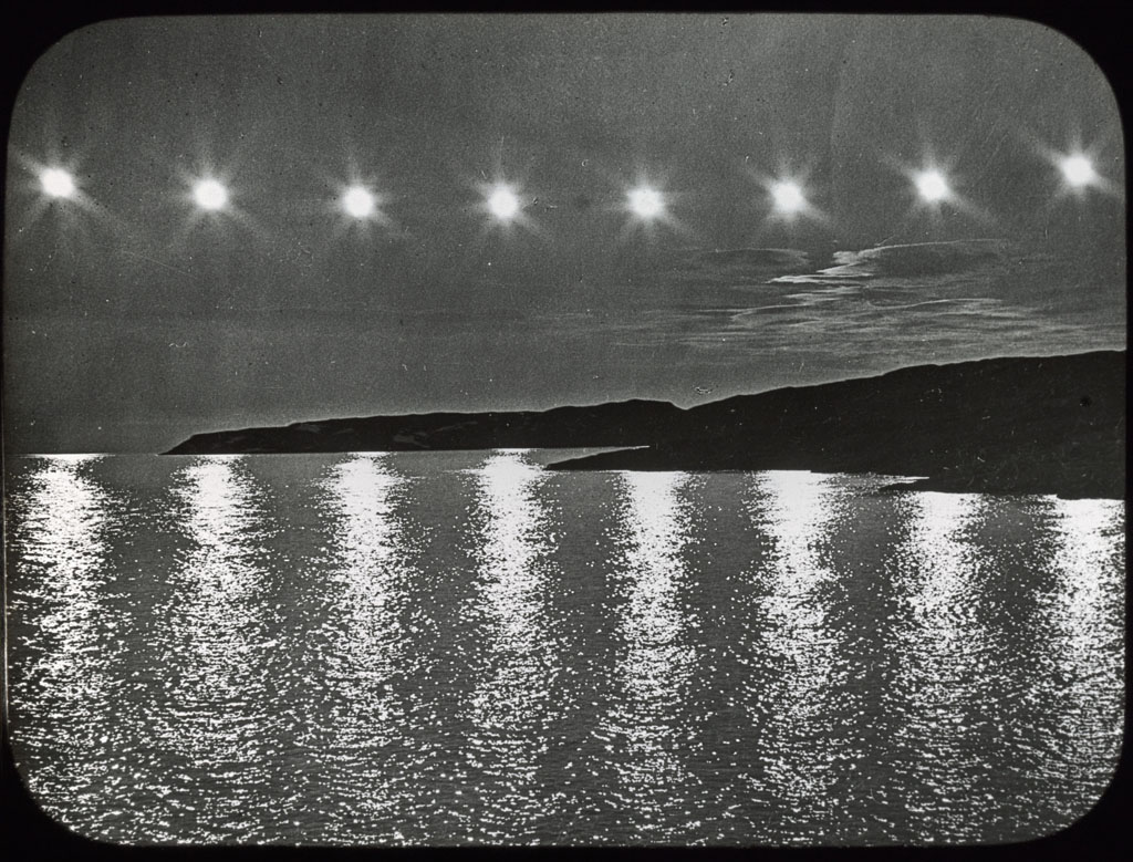 Donald Baxter MacMillan; Eight suns before and after midnight; 1913-1917; image; silver gelatin on glass; 10.16 cm x 8.26 cm x 0.64 cm (4 in. x 3 1/4 in. x 1/4 in.); TGM; North America