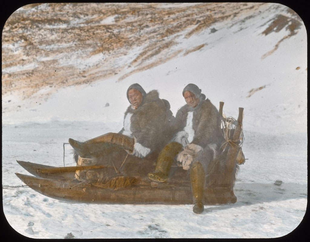 Two women on sledge at Etah