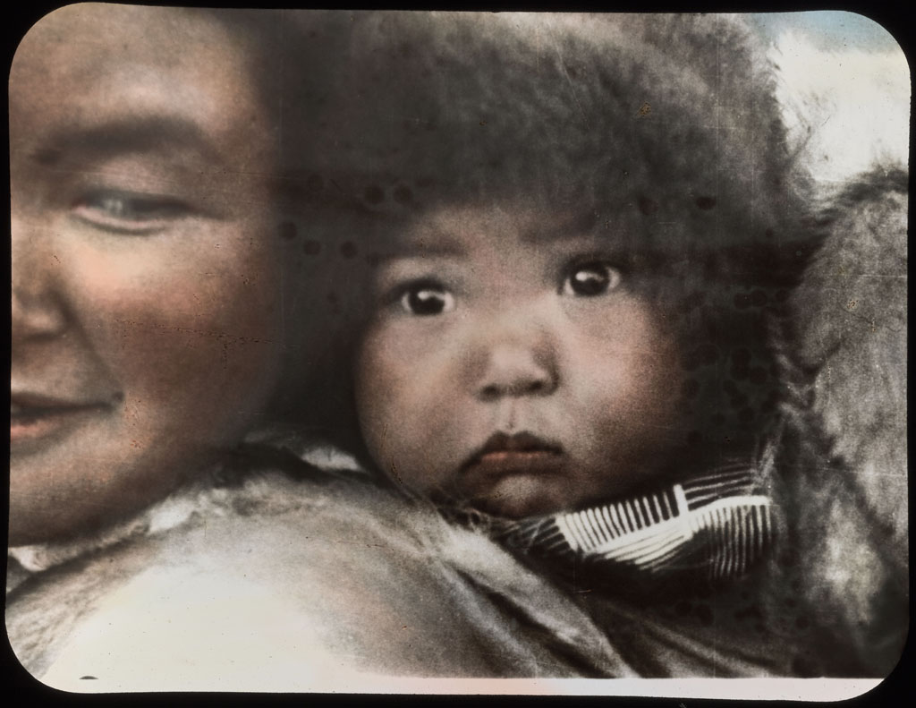 Donald Baxter MacMillan; Eskimo mother and baby; 1913-1917; image; silver gelatin on glass; 10.16 cm x 8.26 cm x 0.64 cm (4 in. x 3 1/4 in. x 1/4 in.); TGM; North America