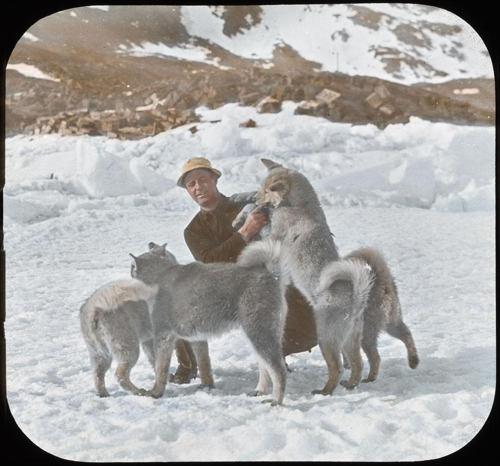 Donald Baxter MacMillan; Dogs and MacMillan; 1913-1917; image; silver gelatin on glass; 10.16 cm x 8.26 cm x 0.64 cm (4 in. x 3 1/4 in. x 1/4 in.); TGM; North America