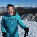 Portrait of Dr. Jacky Baughman, Director of the Bowdoin Emerging Technologies Lab, backcountry skiing in Colorado.