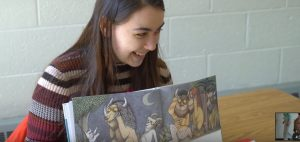 Bowdoin student reading Where the Wild Things Are in Ukrainian